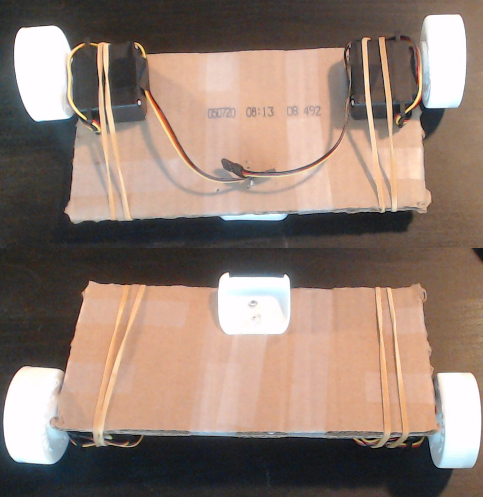 Top and bottom of the robot chassis with both wheels and the caster attached.