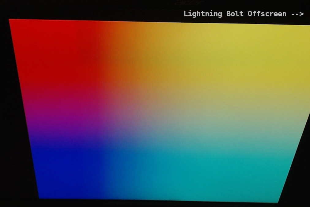 Photo of monitor with Raspberry Pi error, showing rainbow screen with lightning bolt.